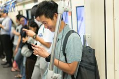 Happy man is traveler using smartphone at subway for travel stock photo