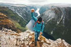 Happy Man traveling in Norway mountains active lifestyle Stock Photo