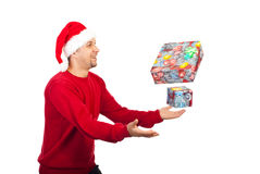 Happy man trying to catch Christmas gifts Stock Photo
