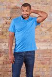 Happy man in a tshirt. Portrait of a happy handsome young man in a blue tshirt stock photography