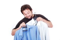 Happy man with two fasioned shirts Royalty Free Stock Images