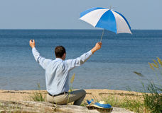 Happy man with umbrella Stock Image