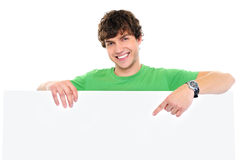 Happy Man Under Blank Banner And Showing On It Stock Images