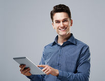 Young man with tablet Stock Photos