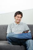 Happy Man Using Digital Tablet Royalty Free Stock Photo