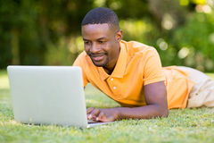 Happy man using his laptop Royalty Free Stock Photos
