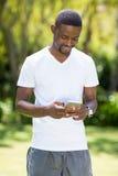Happy man using his smartphone Stock Photography