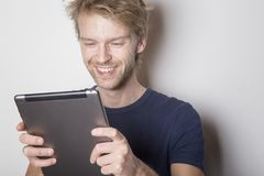 Happy man using his tablet Stock Photo