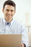 Happy man using laptop Stock Photo