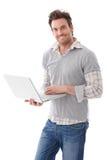 Happy man using laptop Stock Photo