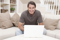 Happy Man Using Laptop Computer At Home Royalty Free Stock Image