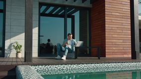 Happy man using laptop at luxury house. Business man using technology at home stock footage
