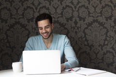 Happy man using a laptop Royalty Free Stock Photo