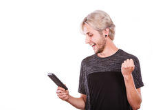 Happy man using mobile phone read message Royalty Free Stock Image