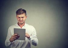 Happy man using new tablet royalty free stock photo