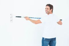 Happy man using paint roller Royalty Free Stock Photography