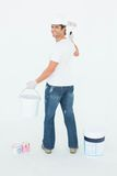 Happy man using paint roller Stock Photography