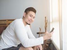 Happy man using smartphone. stock photos