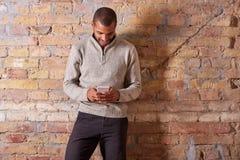 Happy man using smartphone Stock Image