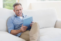 Happy man using tablet computer Royalty Free Stock Images