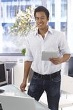 Happy man using tablet computer Royalty Free Stock Photo