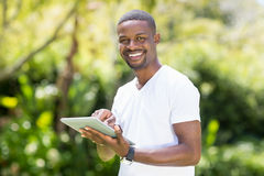 Happy man using a tablet Stock Image