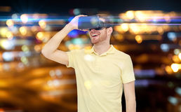 Happy man in virtual reality headset or 3d glasses Royalty Free Stock Photo
