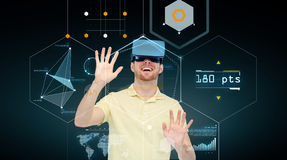 Happy man in virtual reality headset or 3d glasses. 3d technology, virtual reality, cyberspace, entertainment and people concept - happy young man in virtual Stock Images