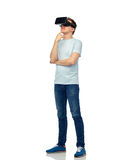 Happy man in virtual reality headset or 3d glasses. 3d technology, virtual reality, entertainment, cyberspace and people concept - happy young man with virtual Royalty Free Stock Photos