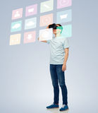 Happy man in virtual reality headset or 3d glasses Royalty Free Stock Image