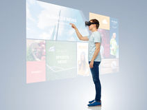 Happy man in virtual reality headset or 3d glasses Stock Image