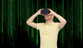 Happy man in virtual reality headset or 3d glasses. 3d technology, virtual reality, entertainment and people concept - happy young man with virtual reality Stock Photography