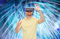 Happy man in virtual reality headset or 3d glasses Stock Photos
