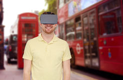 Happy man in virtual reality headset or 3d glasses Stock Photo
