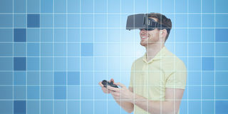 Happy man in virtual reality headset with gamepad Royalty Free Stock Images