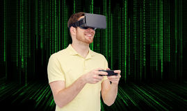 Happy man in virtual reality headset with gamepad Royalty Free Stock Image