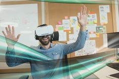 Happy man in VR headset looking to green lights interfaces stock image