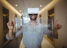 Happy man in VR headset touching interface. Digital composite of Happy man in VR headset touching interface Royalty Free Stock Photo