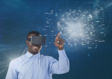 Happy man in VR headset touching interface with flares against blue background. Digital composite of Happy man in VR headset touching interface with flares Stock Images