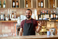 Happy man or waiter with coffee and sugar at bar Stock Photo