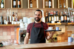 Happy man or waiter with coffee and sugar at bar Royalty Free Stock Photos