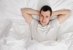 Happy man wakening up Royalty Free Stock Images