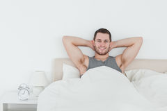 Happy man waking up. In his bedroom royalty free stock photo