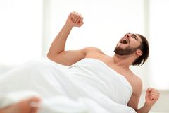 Happy man waking up in the morning. Photo with copy space Royalty Free Stock Photography