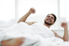 Happy man waking up in the morning. Photo with copy space Stock Photo