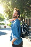 Happy man walking away with travel bag Royalty Free Stock Photo