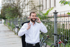 Happy man walking on a sidewalk Royalty Free Stock Image