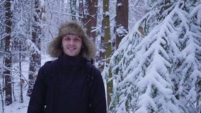 Happy man walks in the cold winter forest covered with snow. Hd stock footage
