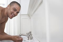 Happy Man Washing Face Stock Photos