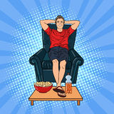 Happy Man Watching TV on the Chair Stock Image